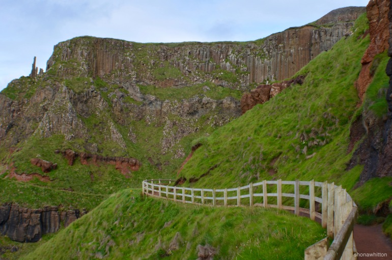 Chimneys in the distance. Giant's Causeway, Northern Ireland.